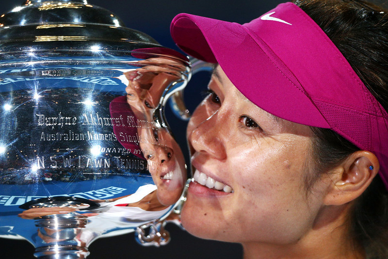 . Na Li of China holds the Daphne Akhurst Memorial Cup after winning the women\'s final match against Dominika Cibulkova of Slovakia during day 13 of the 2014 Australian Open at Melbourne Park on January 25, 2014 in Melbourne, Australia.  (Photo by Graham Denholm/Getty Images)