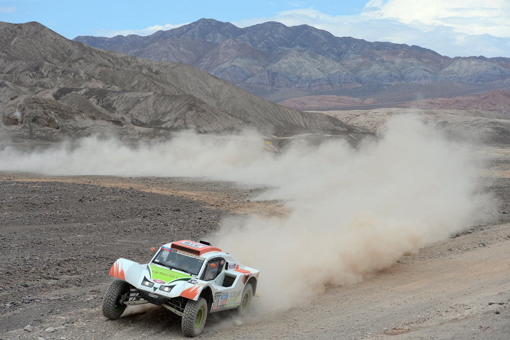 Description of . Ronan Chabot and co-driver Gilles Pillot of team SMG compete in stage 6 from Arica to Calama during the 2013 Dakar Rally on January 10, 2013 in Arica, Chile.  (Photo by Shaun Botterill/Getty Images)