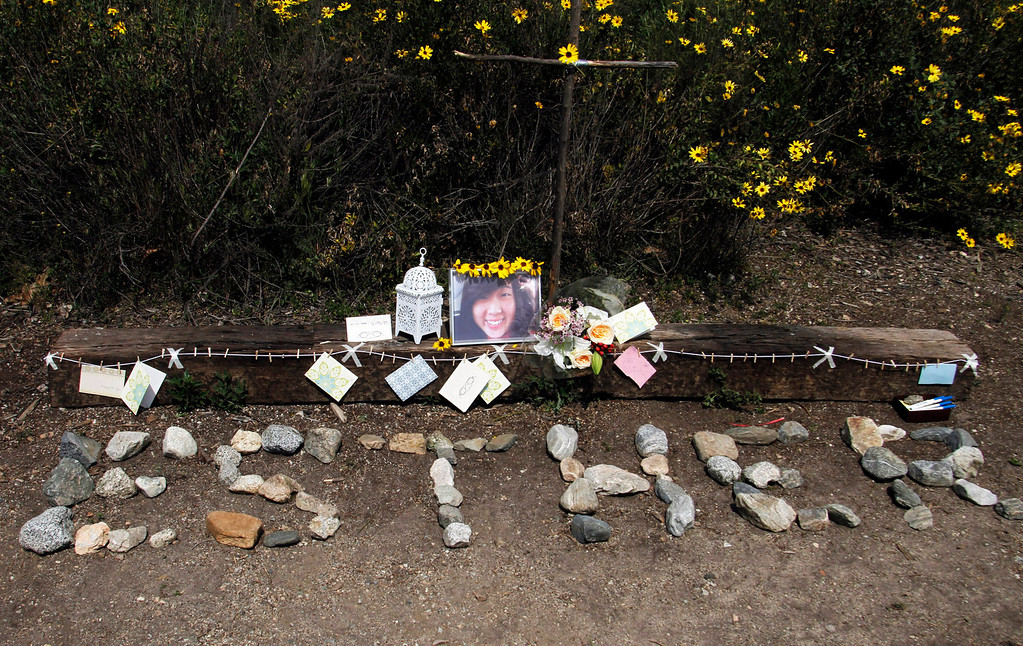 ". Stones are placed to read ""Esther\"" at a memorial for Esther Suen, at the start of the hiking trail, at Eaton Canyon Park in Altadena, Monday, March 25, 2013. Esther Suen a 17-year old Mark Keppel High School student fell 200 feet and was killed on a hiking accident on Friday at Eatyon Canyon Park. (Correspondent Photo by James Carbone/SXCITY)"