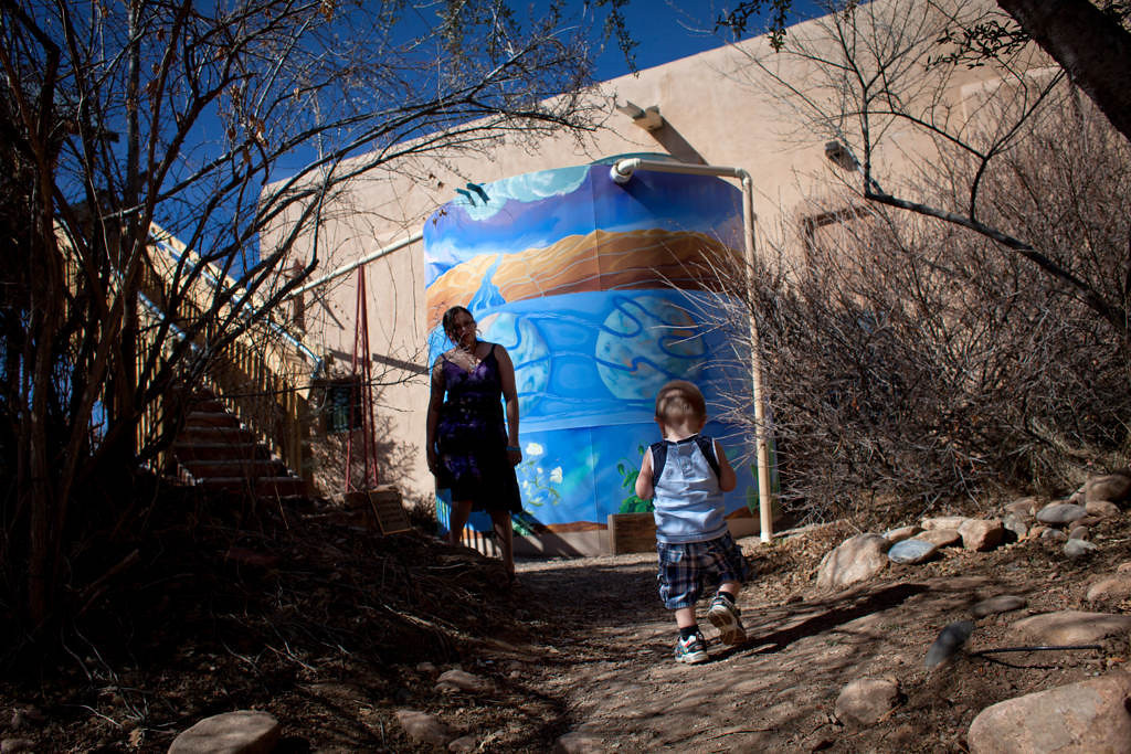 . A colorfully-painted tank holding approximately 13,000 usable gallons of rain water and snow melt from the roof of the Santa Fe Children\'s Museum in Santa Fe is part of an ongoing catchment project to provide water for the museum\'s nature center, which includes a vegetable and herb garden. The project also includes a series of catchment ponds that save runoff from the museum\'s sloped parking lot during rain storms. Further development and implementation of the project is on hold as the museum seeks additional funding sources. (Special to the Pioneer Press: Mark Holm)