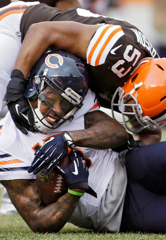. Chicago Bears wide receiver Brandon Marshall (15) is tackled by Cleveland Browns inside linebacker Craig Robertson (53) after a catch in the first quarter of an NFL football game, Sunday, Dec. 15, 2013, in Cleveland. (AP Photo/Tony Dejak)