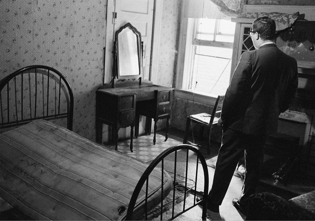 . A news reporter stands in the room rented by the assassin who shot Dr. Martin Luther King Jr., in Memphis, Tenn., April 5, 1968.  From an adjacent bathroom window, the assassin shot and killed the civil rights leader who was standing on the balcony of the Lorraine Motel in Memphis, Tennessee on April 4.  (AP Photo)
