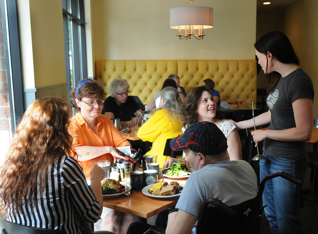 . Alicia Hinze, right, pastry chef and co-owner of the Buttered Tin, chats with lunchtime customers. (Pioneer Press: Jean Pieri)