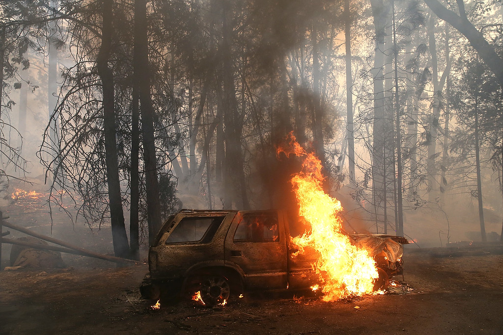 . Flames billow from the front of a car that was consumed by the Rim Fire on August 25, 2013 near Groveland, California.   (Photo by Justin Sullivan/Getty Images)