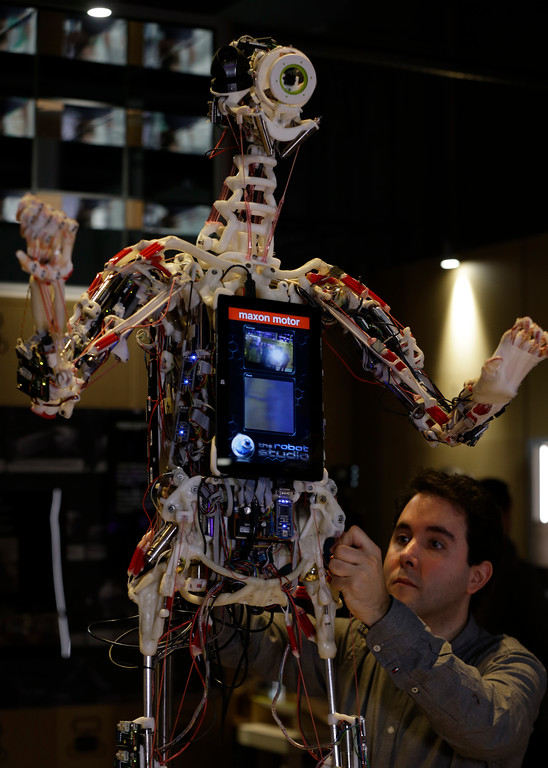 . A technician adjusts Rob\'s Open Source Android (ROSAL) which was built in France from 2010-2016, and is part of the new Robot exhibition staged at the Science Museum during a press preview in London, Tuesday, Feb. 7, 2017. The exhibition which shows 500 years of mechanical and robotic advances is open to the public form Feb. 8 through to Sept. 3. (AP Photo/Alastair Grant)