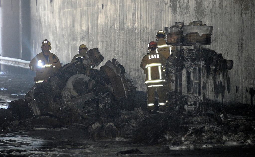 . Atwater Village July 13,2013. LA city firefighters look one the scene in the tunnel after tanker truck flipped and caught fire in a tunnel beneath a major freeway interchange north of downtown Los Angeles today, causing a major traffic jam, fuel spill into the Los Angeles River and a hazardous smoke scare. Photo by Gene Blevins/LA Daily News