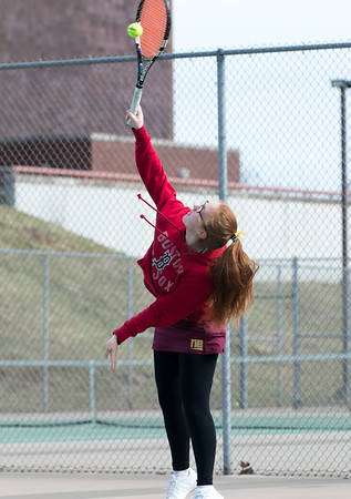 04/02/19 Wesley Bunnell | Staff New Britain girls tennis took on Wilcox Tech in their first matches of the season on Tuesday afternoon. Juju Oliver serves.