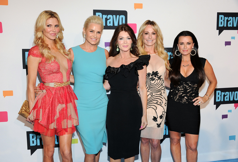 ". ""The Real Housewives of Beverly Hills\"" cast members, from left, Brandi Glanville, Yolanda Foster, Lisa Vanderpump, Taylor Armstrong and Kyle Richards attend the Bravo Network 2013 Upfront on Wednesday April 3, 2013 in New York. (Photo by Evan Agostini/Invision/AP)"