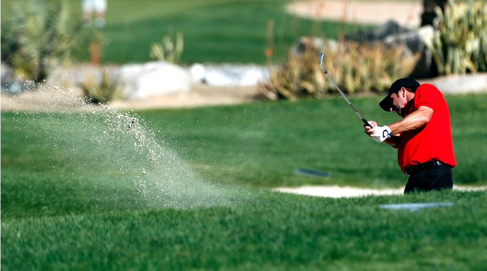 Description of . Jose Maria Olzabal of Spain plays a shot during the second round of the Abu Dhabi Golf Championship at the Abu Dhabi Golf Club in the Emirati capital on January 18, 2013. AFP PHOTO/KARIM SAHIBKARIM SAHIB/AFP/Getty Images