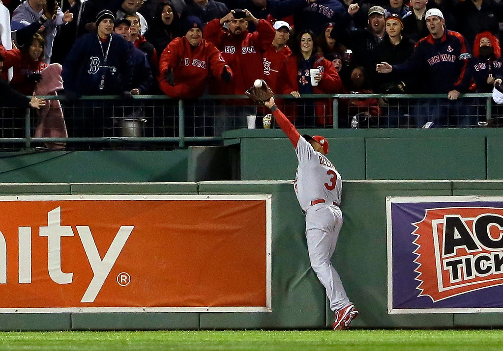 . St. Louis Cardinals\' Carlos Beltran makes a catch by Boston Red Sox\'s David Ortiz during the second inning of Game 1 of baseball\'s World Series Wednesday, Oct. 23, 2013, in Boston. (AP Photo/Matt Slocum)