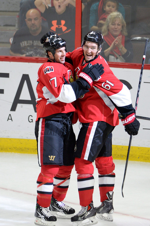 . Ottawa Senators\' David Legwand (17) and Mark Stone (61) celebrate Legwand\'s goal against the Colorado Avalanche during the second period of an NHL hockey game Thursday, Oct. 16, 2014, in Ottawa, Ontario. (AP Photo/The Canadian Press, Justin Tang)