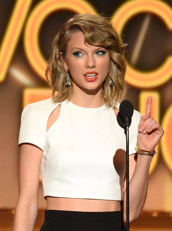 . Singer/songwriter Taylor Swift speaks onstage during the 49th Annual Academy Of Country Music Awards at the MGM Grand Garden Arena on April 6, 2014 in Las Vegas, Nevada.  (Photo by Ethan Miller/Getty Images)