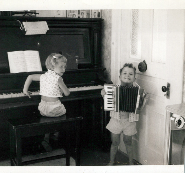 1950s girl with piano and Butch with accordian.jpeg