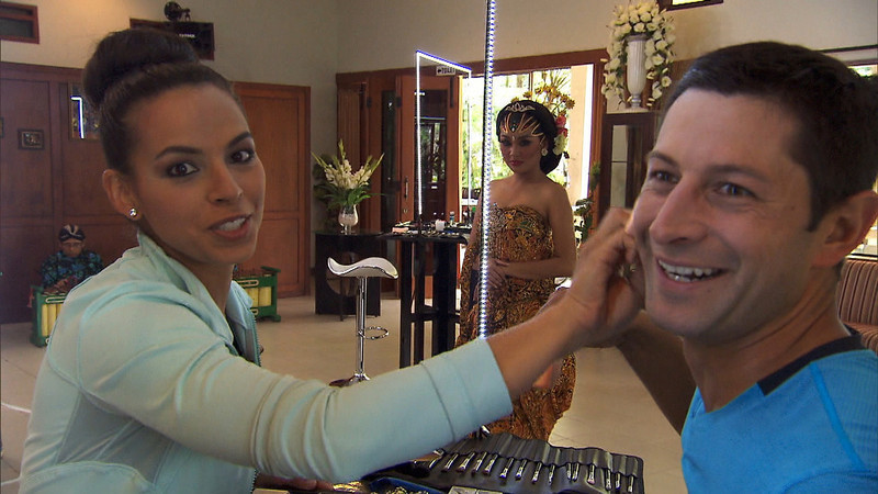 """. \""""Cobra in my Teeth\""""-- In Detour A, Dating couple Amy (left) and Jason (right) must make each other up as a traditional Javanese bride in order to receive the next clue on THE AMAZING RACE, Sunday, Dec 1 (8:00-9:00 PM, ET/PT) on the CBS Television Network. Photo: CBS©2013 CBS Broadcasting, Inc. All Rights Reserved"""
