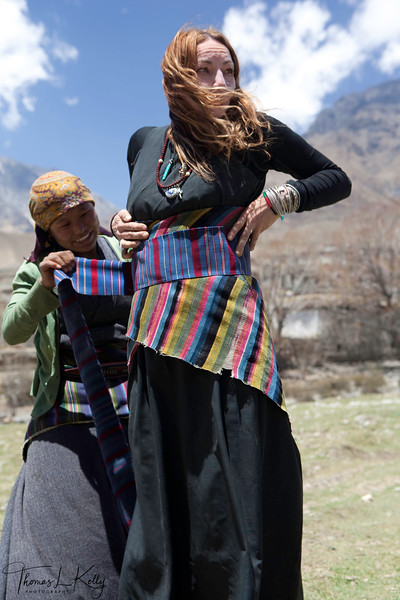 Cindy Many buys traditional attier in Dhakmar. Mustang, Nepal.