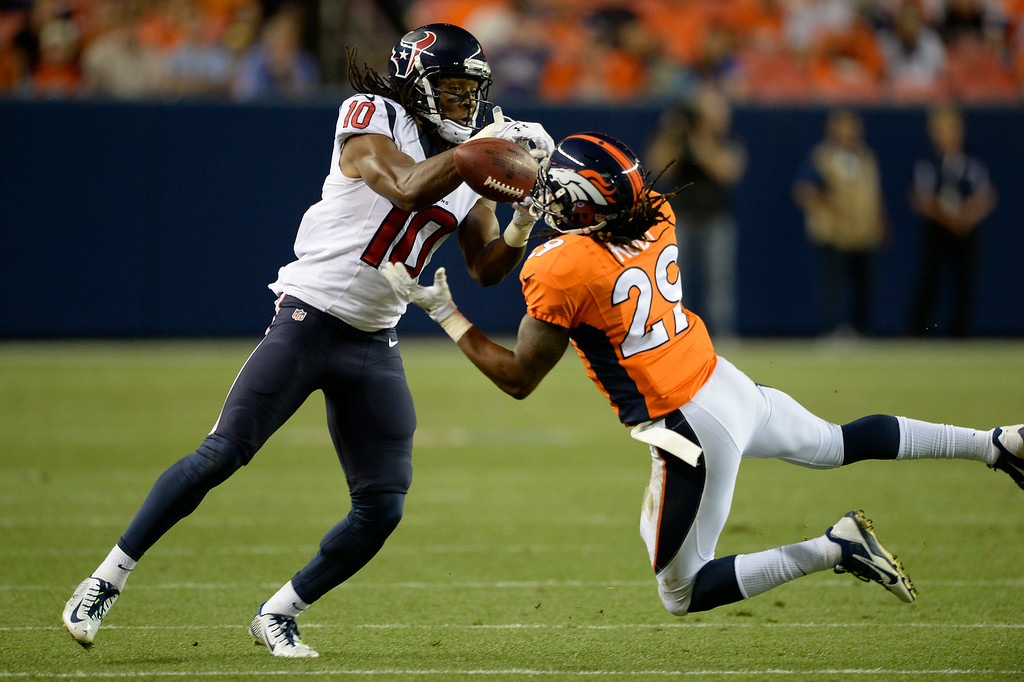 . DENVER, CO - AUGUST 23: Denver Broncos cornerback Bradley Roby (29) just about grabs an interception on a pass intended for Houston Texans wide receiver DeAndre Hopkins (10) during the second quarter August 23, 2014 at Sports Authority Field at Mile High Stadium. (Photo by John Leyba/The Denver Post)
