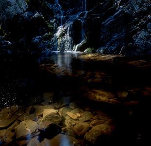 Waterfall splashing in a shallow pond