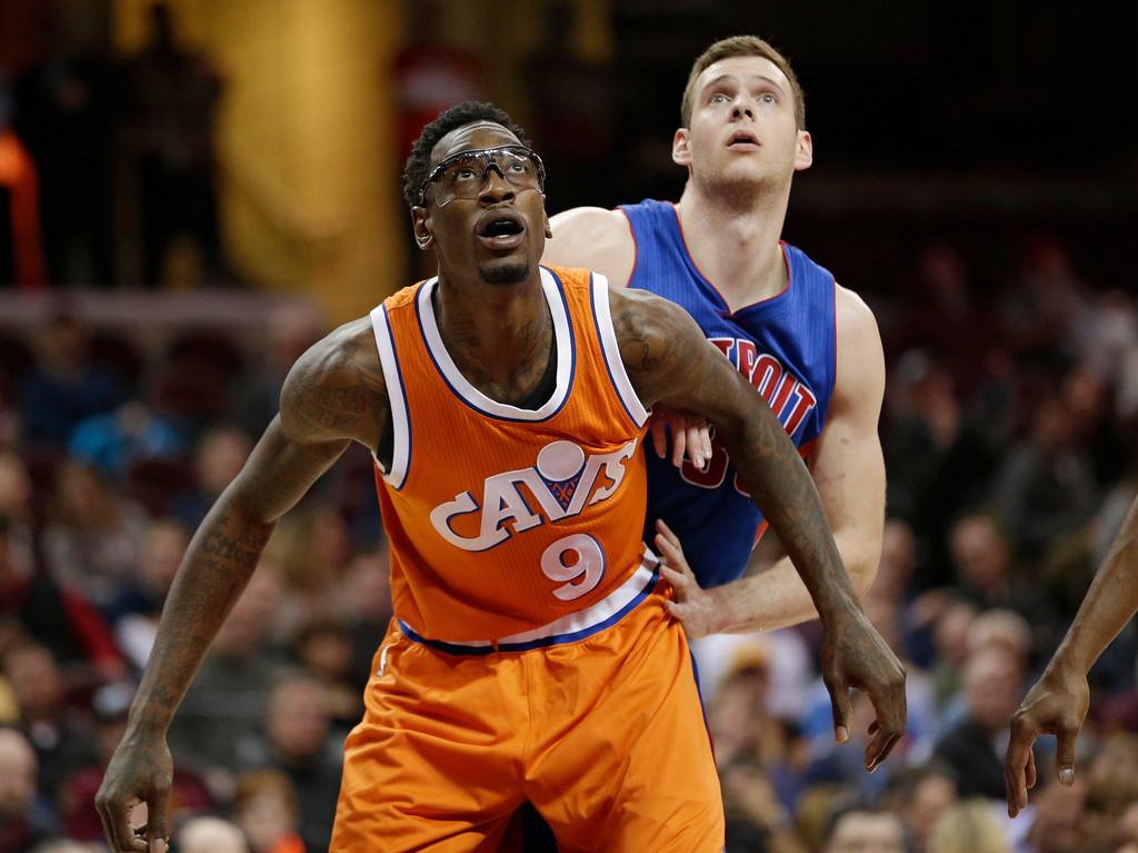 . Cleveland Cavaliers\' Larry Sanders (9) blocks out Detroit Pistons\' Jon Leuer (30) in the second half of an NBA basketball game, Tuesday, March 14, 2017, in Cleveland. (AP Photo/Tony Dejak)