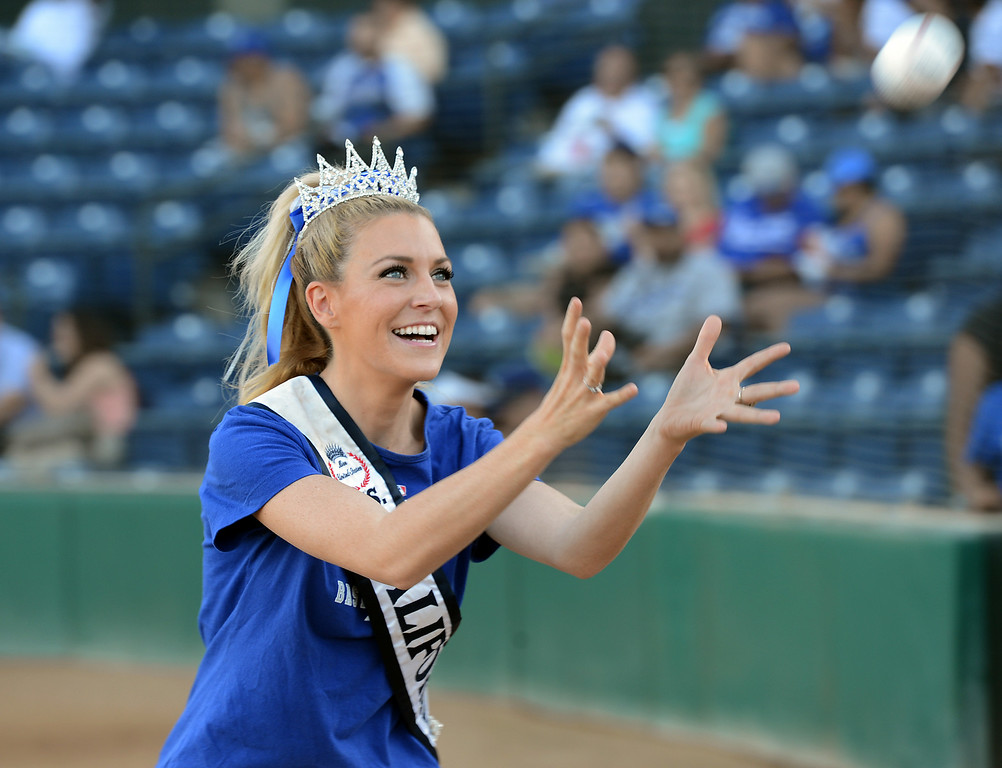 . Ms. California 2014 Sande Charles warms up before throwing out the first pitch at the Quakes game at LoanMart Field in Rancho Cucamonga, CA, Friday, August 15, 2014. (Photo by Jennifer Cappuccio Maher/Inland Valley Daily Bulletin)