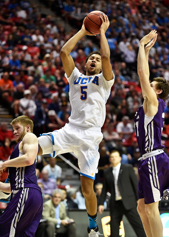 . UCLA guard Kyle Anderson (5) goes in for a score during the first half of a third-round game in the NCAA college basketball tournament, Sunday, March 23, 2014, in San Diego. (AP Photo/Denis Poroy)