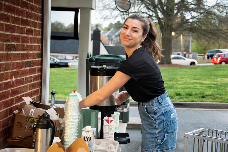 Abby Thompson flashes a smile in the midst of the flurry of business at the temporary drive-thru location. (Bill Giduz photo)
