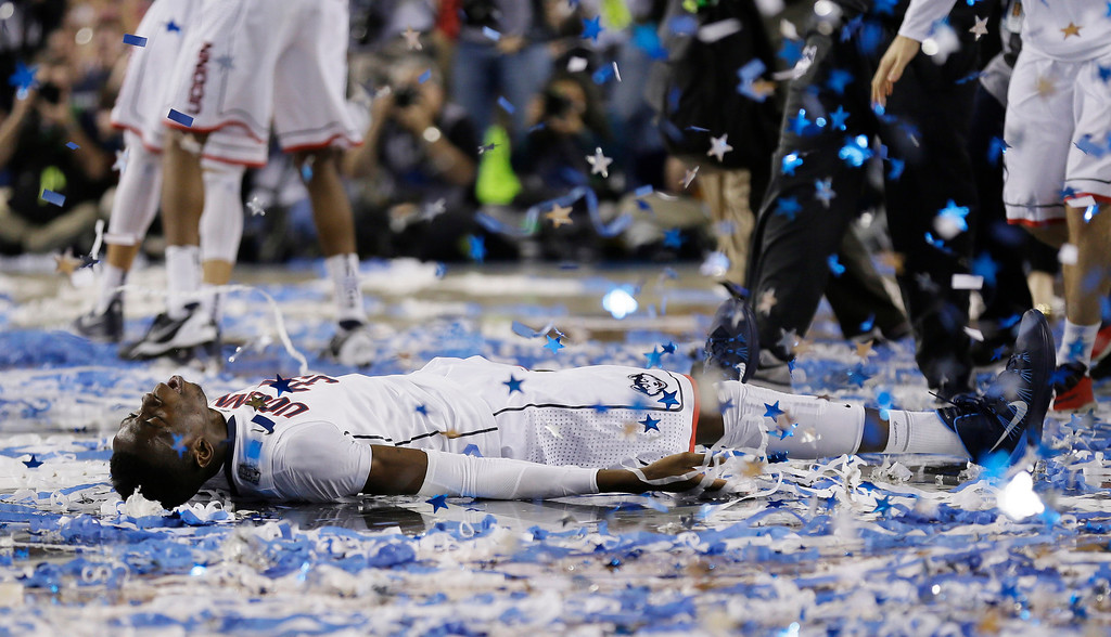 . Connecticut center Amida Brimah celebrates after winning the NCAA Final Four tournament college basketball championship game 60-54, against Kentucky Monday, April 7, 2014, in Arlington, Texas. (AP Photo/Charlie Neibergall)