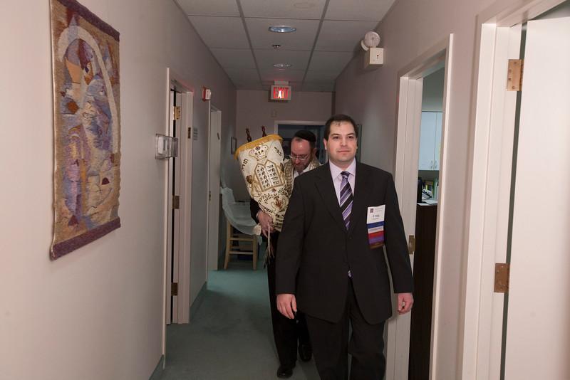 Craig escorts Rabbi Youlus and the Torah scroll to the sanctuary