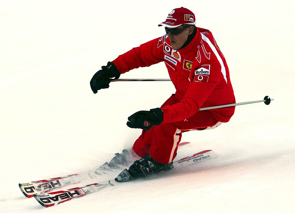 . FILE - In this Thursday, Jan. 12, 2006 file photo provided by the Ferrari press office, Formula One driver Michael Schumacher of Germany speeds down a course in the Madonna di Campiglio ski resort, in the Italian Alps .  French radio says retired Formula One champion Michael Schumacher has been injured in a skiing accident.  RMC radio reported Sunday Dec. 29, 2013 that the seven-time champion had fallen while skiing off-piste at the French Alpine resort of Meribel.  The radio quoted resort director Christophe Gernigon-Lecomte as saying that Schumacher was wearing a helmet when he fell and hit a rock.  (AP Photo/Ferrari, File)