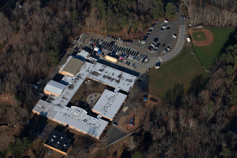 Description of . Sandy Hook Elementary School is seen in this aerial photograph a day after a mass shooting in Newtown, Connecticut December 15, 2012. Investigators assembled