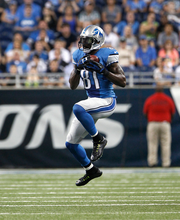 . Detroit Lions wide receiver Calvin Johnson (81) catches a pass against the Jacksonville Jaguars in the first half of a preseason NFL football game at Ford Field in Detroit, Friday, Aug. 22, 2014.  (AP Photo/Duane Burleson)