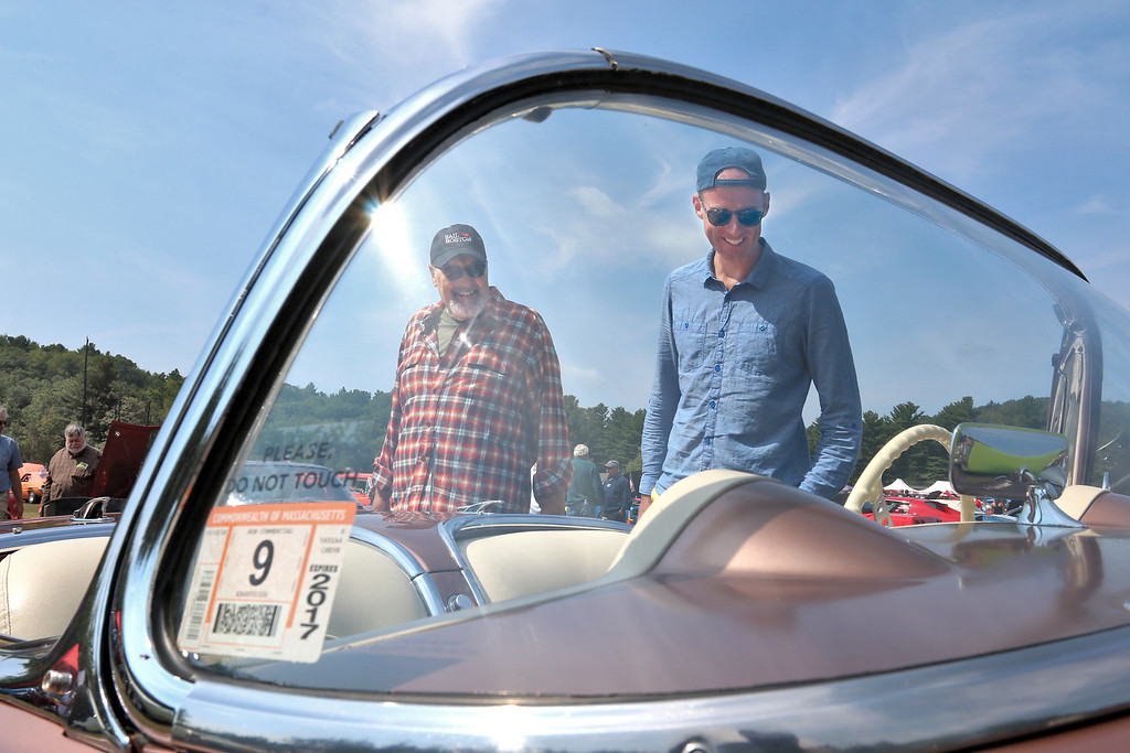 . Asbhy American Legion held its 8th annual Holmes Curran Bennett Post 361 car show fundraiser for veterans on Monday, Labor Day at Allen Field. From left is Jim Mullins and his son Brandan Mullins from Ashby looking over a 1956 Chevrolet Corvette from Pepperell at the show. SENTINEL & ENTERPRISE/JOHN LOVE