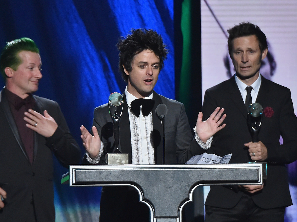 . Inductees Tre Cool, Billie Joe Armstrong and Mike Dirnt of Green Day speak onstage during the 30th Annual Rock And Roll Hall Of Fame Induction Ceremony at Public Hall on April 18, 2015 in Cleveland, Ohio.  (Photo by Mike Coppola/Getty Images)