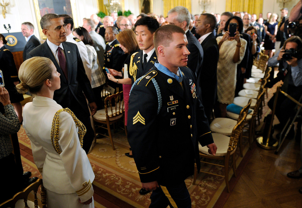 . President Barack Obama follows the newest Medal of Honor recipient, former Army Sgt. Kyle J. White, following a ceremony in the East Room of the White House in Washington, Tuesday, May 13, 2014.  (AP Photo)