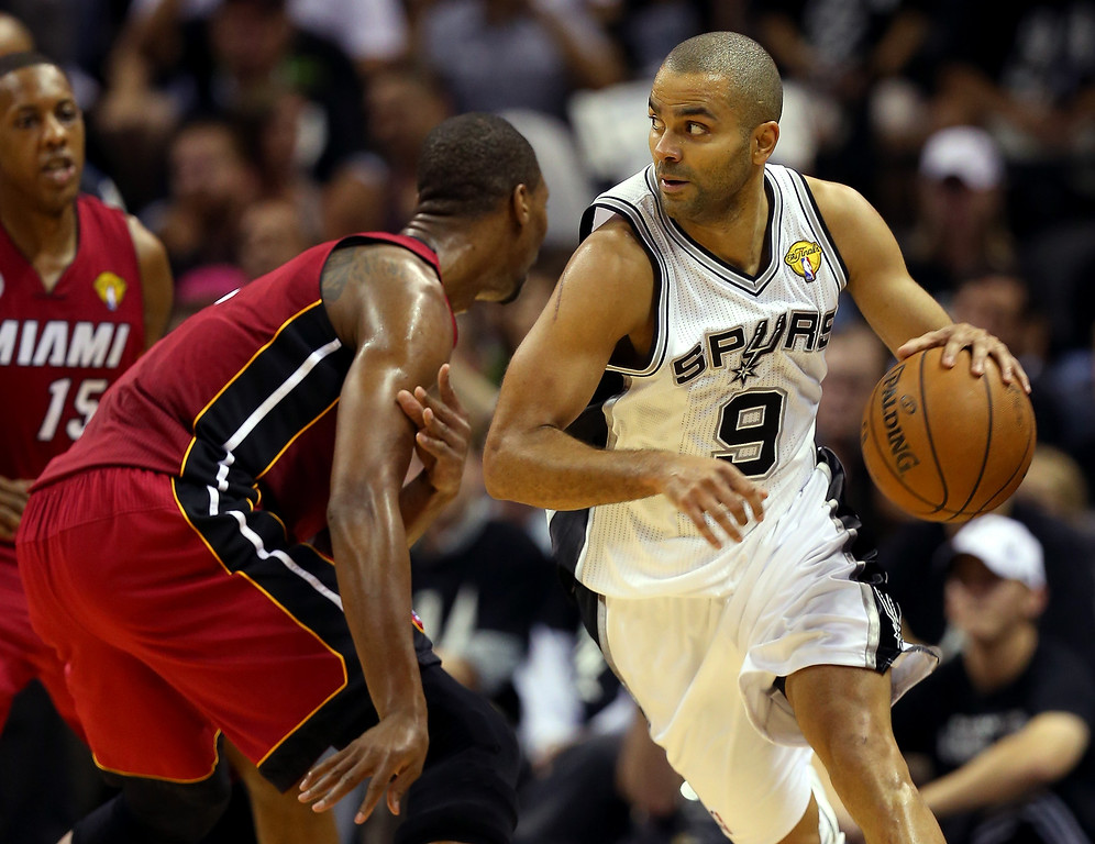 . Tony Parker #9 of the San Antonio Spurs moves the ball against Chris Bosh #1 of the Miami Heat in the third quarter during Game Three of the 2013 NBA Finals at the AT&T Center on June 11, 2013 in San Antonio, Texas.   (Photo by Mike Ehrmann/Getty Images)