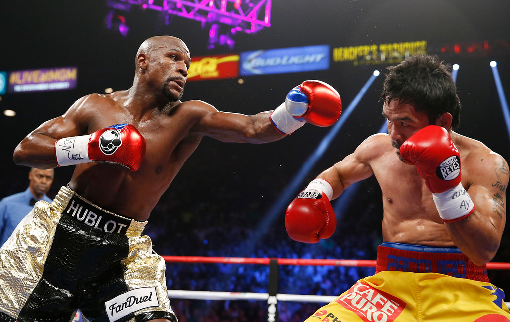 . Floyd Mayweather Jr., left, trades blows with Manny Pacquiao, from the Philippines, during their welterweight title fight on Saturday, May 2, 2015 in Las Vegas. (AP Photo/John Locher)