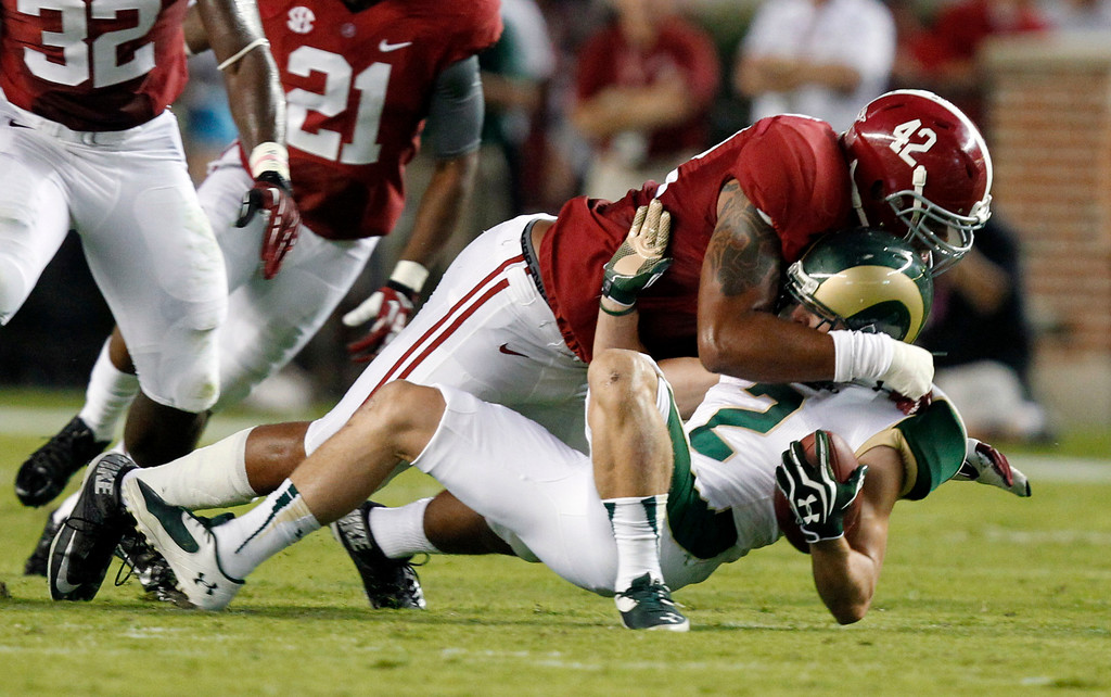 . Alabama linebacker Adrian Hubbard (42) tackles Colorado State wide receiver Thomas Coffman (2) for a loss during the first half of an NCAA college football game Saturday, Sept. 21, 2013, in Tuscaloosa, Ala. (AP Photo/Butch Dill)