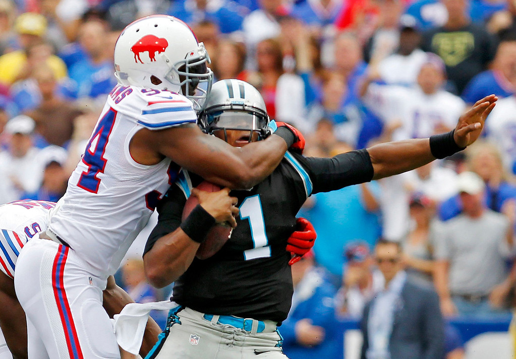 . Carolina Panthers quarterback Cam Newton (1) is tackled by Buffalo Bills defensive end Mario Williams in the first quarter of an NFL football game Sunday, Sept. 15, 2013, in Orchard Park, N.Y. (AP Photo/Bill Wippert)