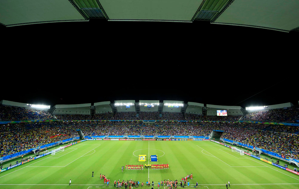 Description of . The teams line up prior to the group G World Cup soccer match between Ghana and the United States at the Arena das Dunas in Natal, Brazil, Monday, June 16, 2014. (AP Photo/Hassan Ammar)