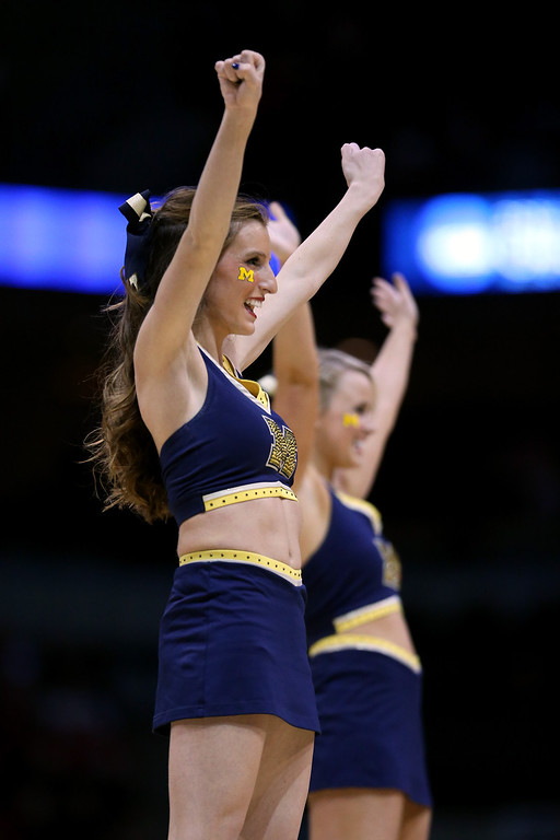 . Michigan Wolverines cheerleaders perform against the Texas Longhorns during the third round of the 2014 NCAA Men\'s Basketball Tournament at BMO Harris Bradley Center on March 22, 2014 in Milwaukee, Wisconsin.  (Photo by Jonathan Daniel/Getty Images)