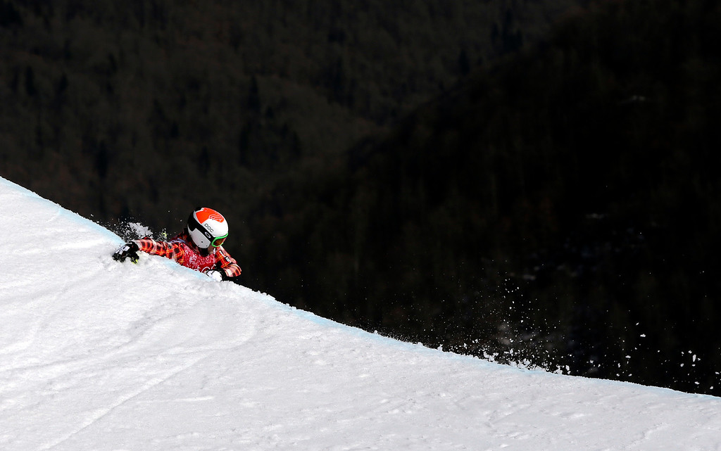 . Canada\'s Brady Leman falls off a jump after crashing in the men\'s ski cross final at the Rosa Khutor Extreme Park at the 2014 Winter Olympics, Thursday, Feb. 20, 2014, in Krasnaya Polyana, Russia. (AP Photo/Sergei Grits)