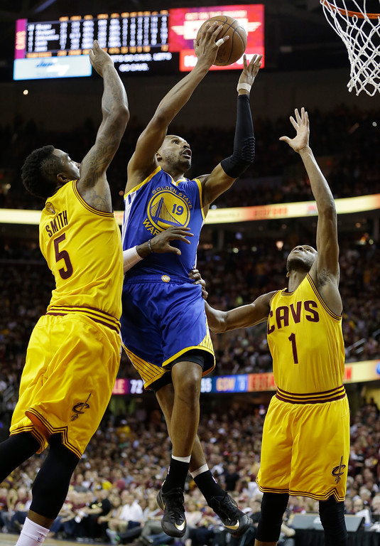 . Golden State Warriors guard Leandro Barbosa (19) attempts a shoot between Cleveland Cavaliers forward James Jones (1) and guard J.R. Smith (5) during the second half of Game 3 of basketball\'s NBA Finals in Cleveland, Tuesday, June 9, 2015. (AP Photo/Tony Dejak)