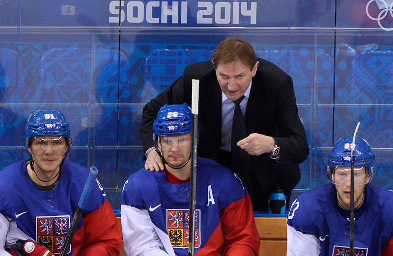 . Czech\'s coach Alois Adamczik (Top) talk to Czech Republic\'s Patrik Elias during the Men\'s Ice Hockey Quarterfinals match between the USA and the Czech Republic at the Shayba Arena during the Sochi Winter Olympics on February 19, 2014. (JONATHAN NACKSTRAND/AFP/Getty Images)