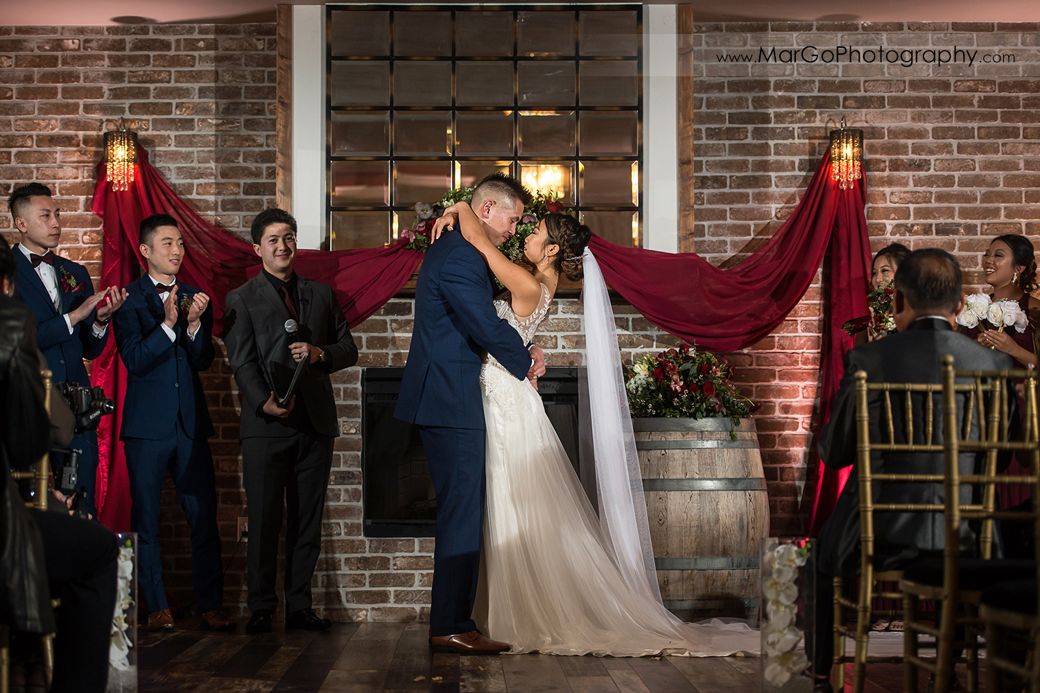 bride and groom kissing during wedding ceremony at Sunol's Casa Bella