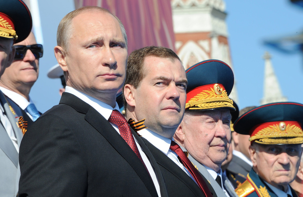 . Russia\'s President Vladimir Putin (L) and Prime Minister Dmitry Medvedev (2nd L) attend a Victory Day parade at the Red Square in Moscow, on May  9, 2014. AFP PHOTO/ RIA-NOVOSTI/ POOL/ MIKHAIL KLIMENTYEV/AFP/Getty Images