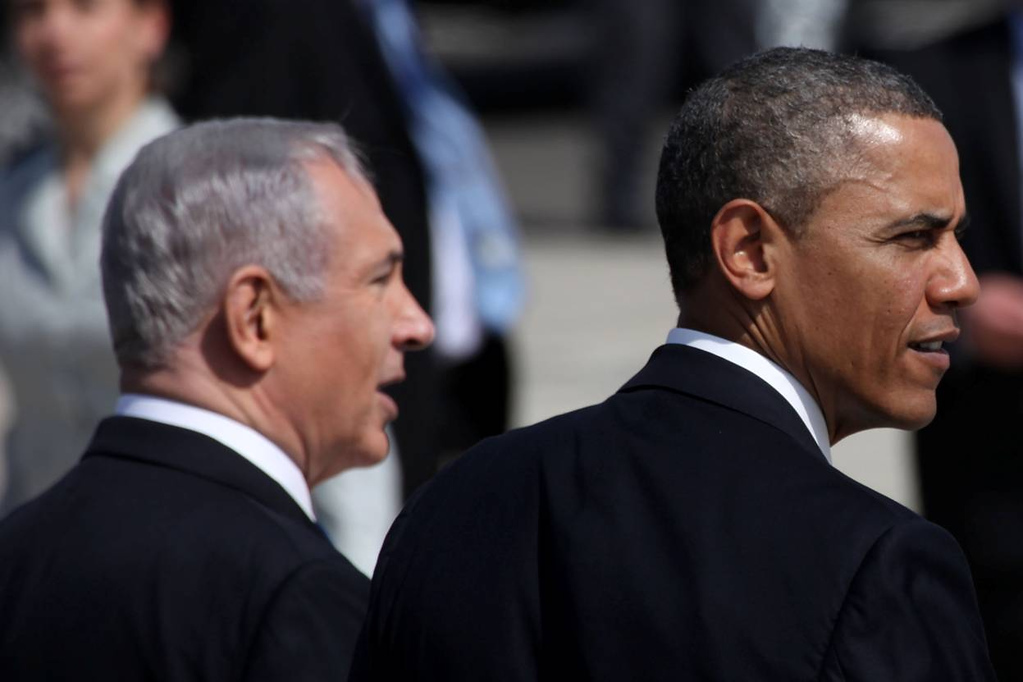 . U.S. President Barack Obama (R) is greeted by Israeli Prime Minister Benjamin Netanyahu during an official welcoming ceremony on his arrival at Ben Gurion International Airport on March, 20, 2013 near Tel Aviv, Israel. (Photo by Marc Israel Sellem-Pool/Getty Images)