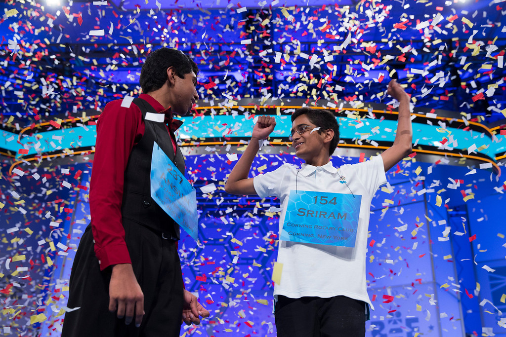 . Ansun Sujoe, 13, of Fort Worth, Texas, left, and Sriram Hathwar, 14, of Painted Post, N.Y., celebrate after being named co-champions of the National Spelling Bee, on Thursday, May 29, 2014, in Oxon Hill, Md. (AP Photo/Evan Vucci)
