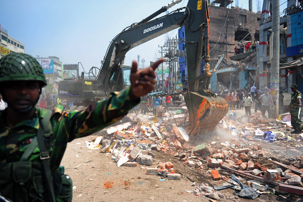 . Bangladeshi Army personnel assist in rescue operations after an eight-story building collapsed in Savar, on the outskirts of Dhaka, on April 24, 2013.  AFP PHOTO/Munir UZ ZAMAN/AFP/Getty Images