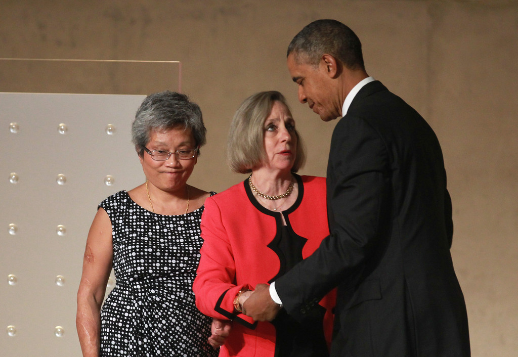 . U.S. President Barack Obama greets Ling Young and Alison Crowther during the dedication ceremony at the National September 11 Memorial Museum May 15, 2014 in New York City. Young escaped the South Tower of the World Trade Center with the help of Crowther\'s son Welles, who died that day.  (John Munson-Pool/Getty Images)