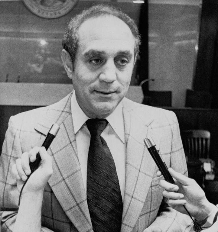 . Las Vegas basketball coach Jerry Tarkanian talks with reporters in the courtroom Sept. 30, 1977 after Clark County District Court Judge James Brennan issued a permanent injunction. The injunction prohibited the university from suspending Tarkanian from his duties as recommended under the terms of a two-year probation placed on the UNLV basketball program by the NCAA. (AP Photo/Jack Thornell)