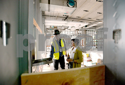 Glenbard Township High School District 87 board members will tour the three-story science addition under construction at Glenbard West High School